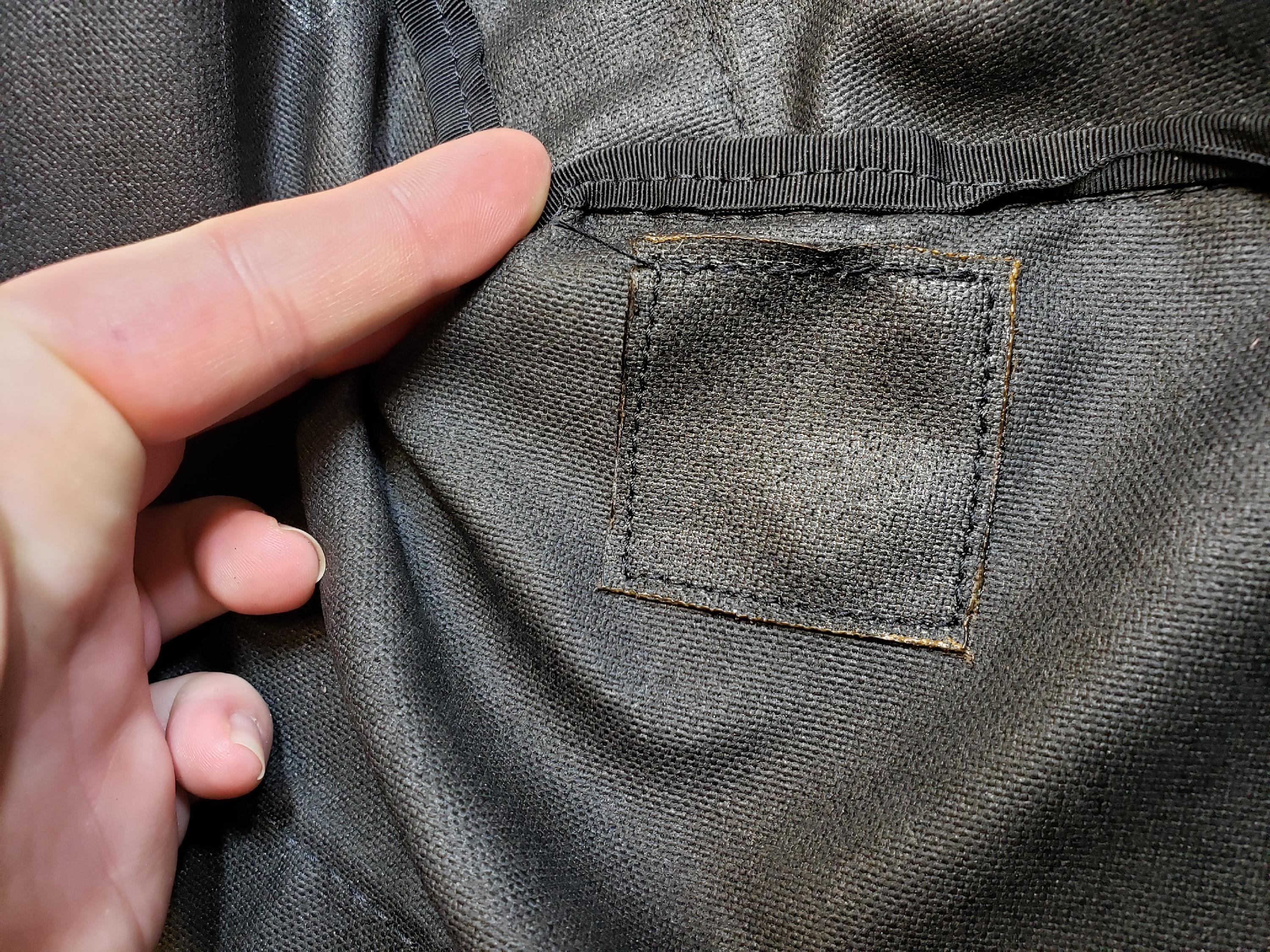 A sample repair patch on a Red Oxx bag.